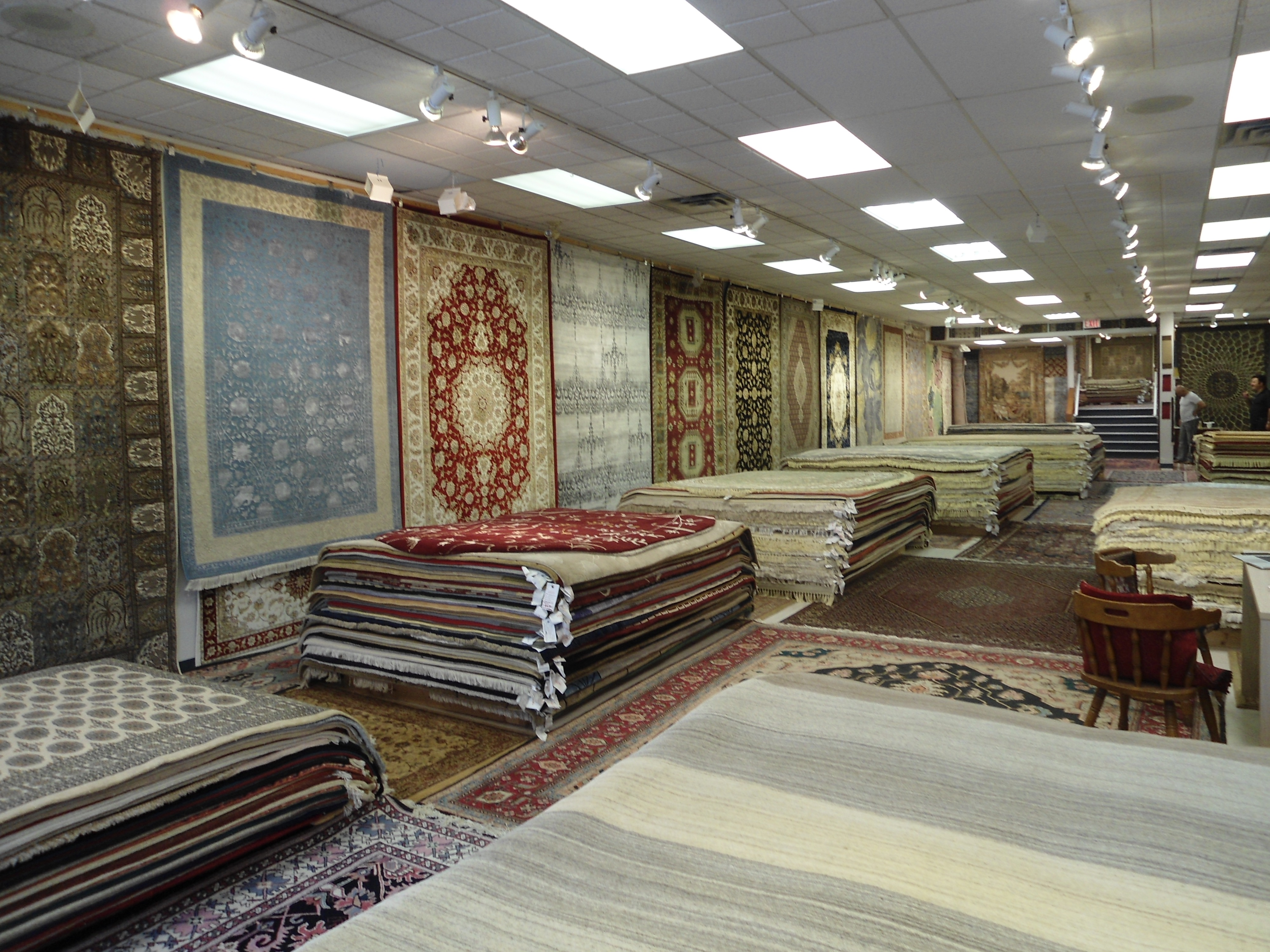 Rug store with area, persian, hand woven rugs etc