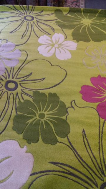 Area rug with flower patterns green white pink